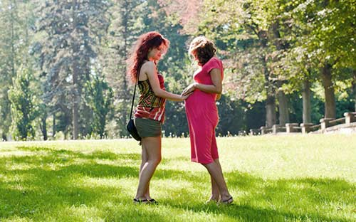 Young women talking together at the park